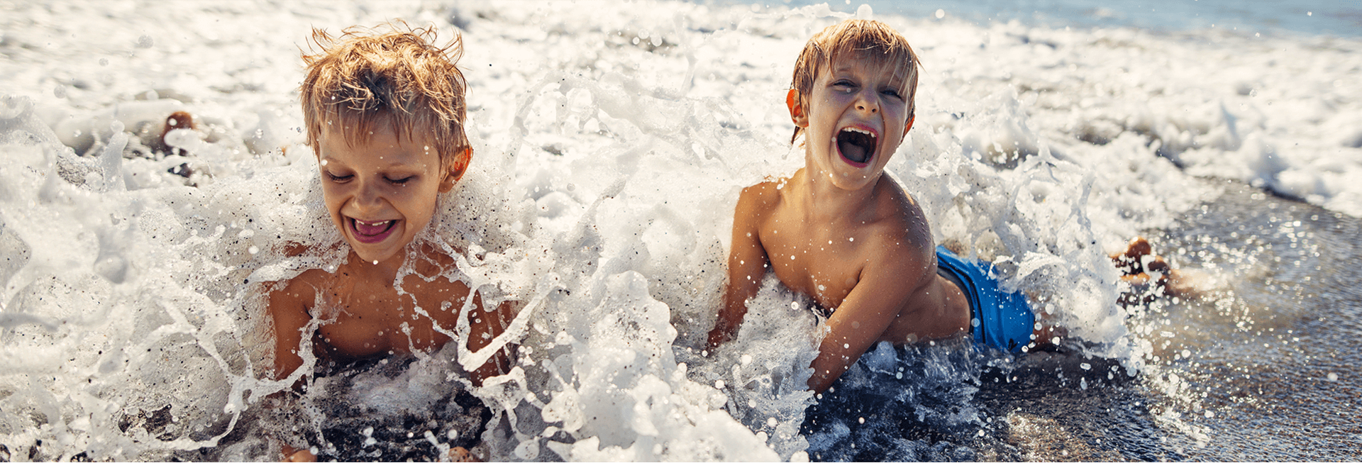 Kids playing in the ocean